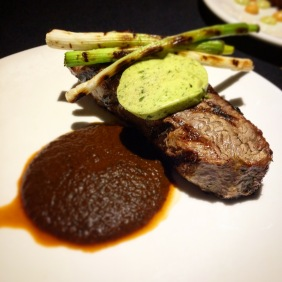 Grilled Black Angus porterhouse with pasilla chilli sauce and anchovy butter