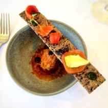 Homage to tomato: organic tomato, basil, black olive lavosh