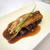 Seared spice-cured kangaroo loin, enoki mushrooms, soy, native pepper, chives