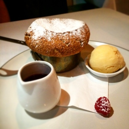 Raspberry soufflé with Champagne ice cream and raspberry sauce