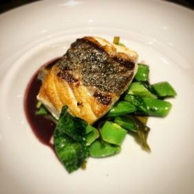 Mulloway with red wine, shallots, fresh peas, wakame and thyme