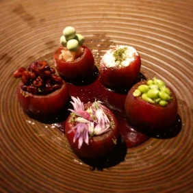Tomatoes stuffed with peas, goat's cheese and pine nuts