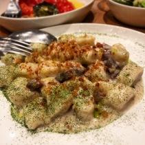 Gnocchi with celeriac cream, air dried pork and bread crumbs