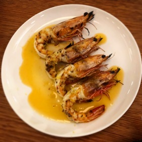 Woodfired king prawns with oregano, chilli and shellfish oil