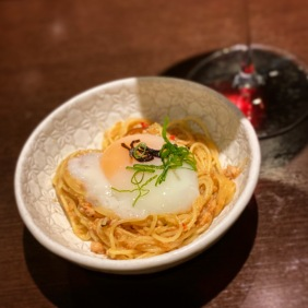 Singapore-style spicy crab capellini with kombu, spring onion and egg