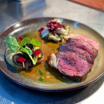 On the pass - Dry aged beef, onions, pickles, beef jus