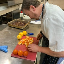 Preparing oranges for the squid dish