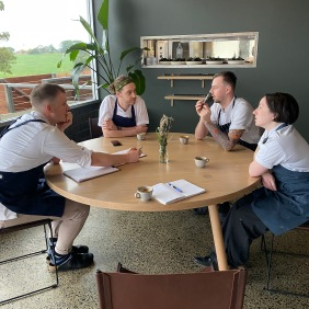 The morning meeting around the Chef's Table